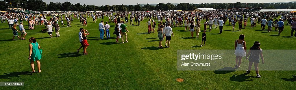 The crowd 'tread in' the pitch during the break during the The Veuve Clicquot Gold Cup for the British Open Polo Championship Final between Dubai and Zacara at Cowdray Park Polo Club on July 21, 2013 in Midhurst, England.