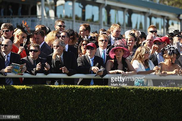 The crowd wait for the start of race five the Darley T J Smith Stakes on AJC Australian Derby Day at Royal Randwick Racecourse on April 9 2011 in...