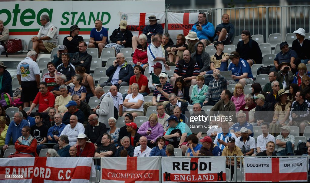 The crowd waits for the start of play as bad light delays the start during day one of the First Test match between New Zealand and England at University Oval on March 6, 2013 in Dunedin, New Zealand.