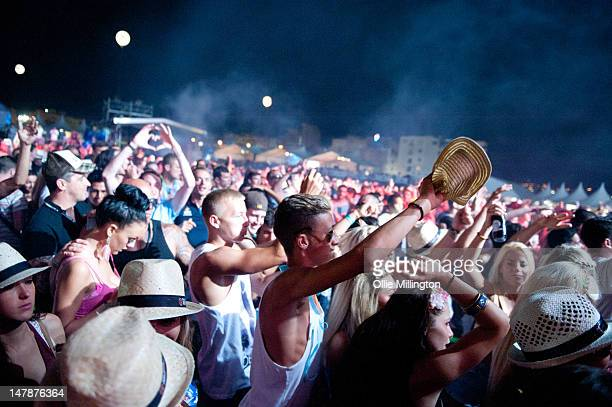The Crowd watch as Steve Angello from Swedish House Mafia performs on the second day onstage at Ibiza 123 Festival Rocktronic Sunset Strip on July 2...