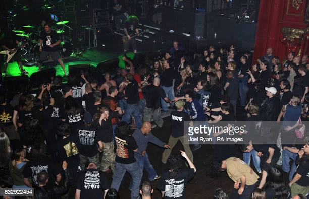 The crowd watch Mark 'Barney' Greenway perform with Napalm Death at KOKO in Camden north London