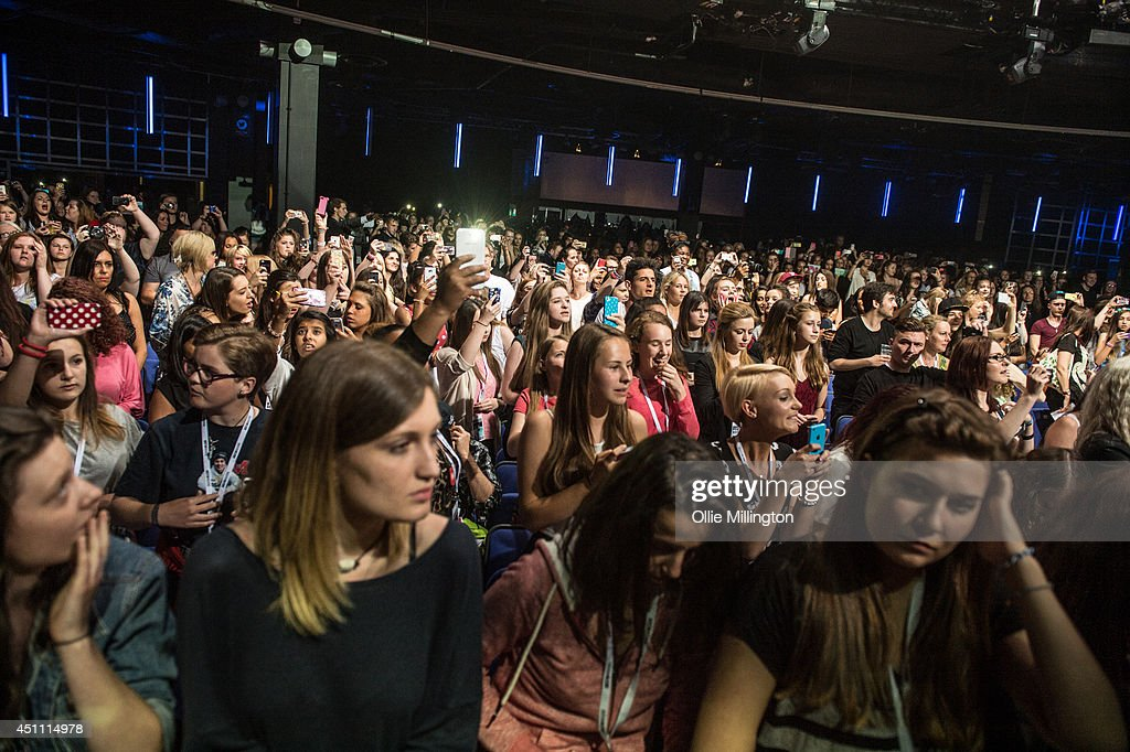 The crowd watch on as Austin Mahone performs during his first UK show onstage at Indigo2 at O2 Arena on June 23, 2014 in London, England.