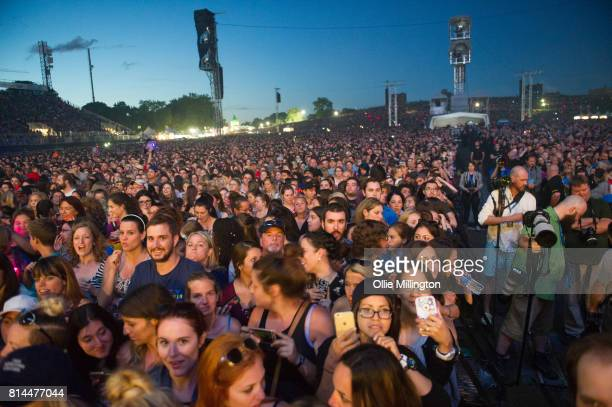 The crowd watch on as Backstreet Boys perform onstage headlining Day 4 of the 50th Festival D'ete De Quebec at Plains of Abraham on the Main stage...