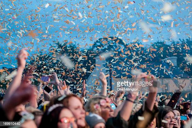The crowd watch on as Bruno Mars performs on stage on Day 3 of The BBC Radio 1 Big Weekend Festival with his backing band The Hooligans on May 26...