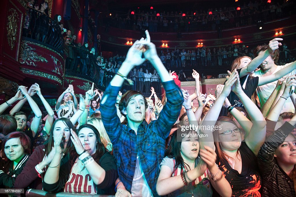 The Crowd watch on as Don Brocco perform onstage during a sold out show on the last night of the Prioroties 2013 album Tour at KOKO on April 18, 2013 in London, England.
