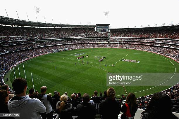 The crowd watch on as Essendon and Collingwood players line up before the start of the round five AFL match between the Collingwood Magpies and the...