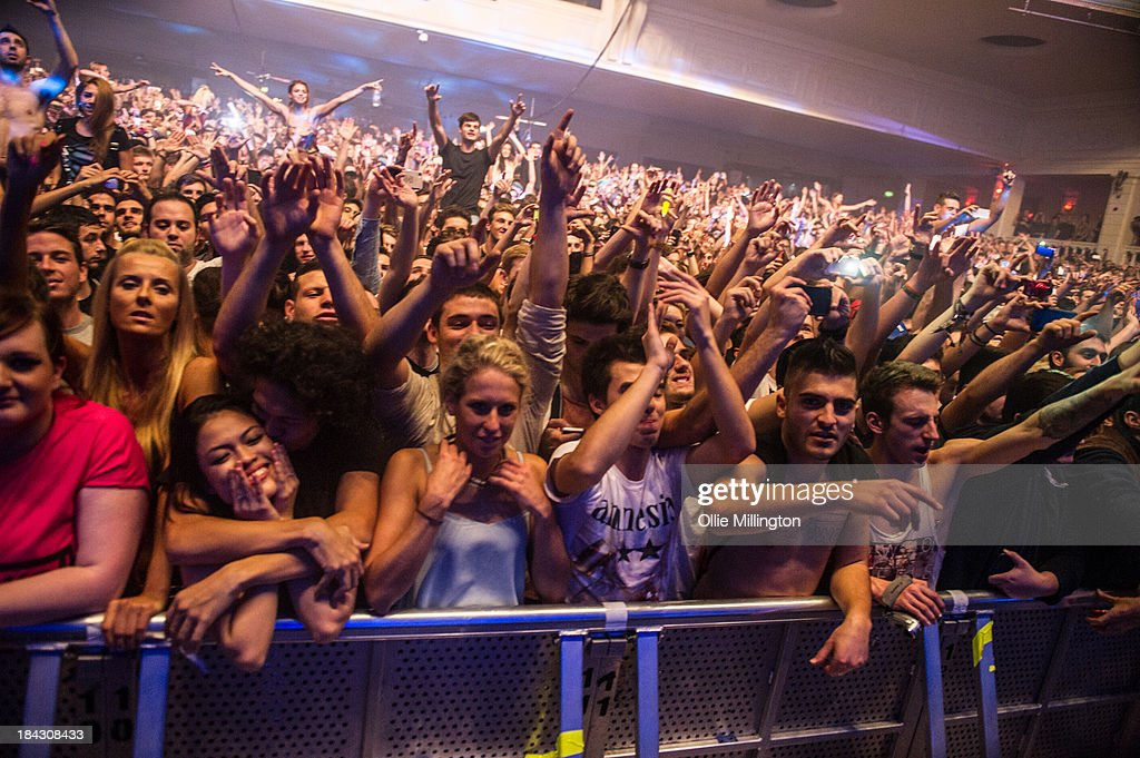 The crowd watch on as Hardwell performs during a date of the I Am Hardwell tour on stage at Brixton Academy on October 12, 2013 in London, England.