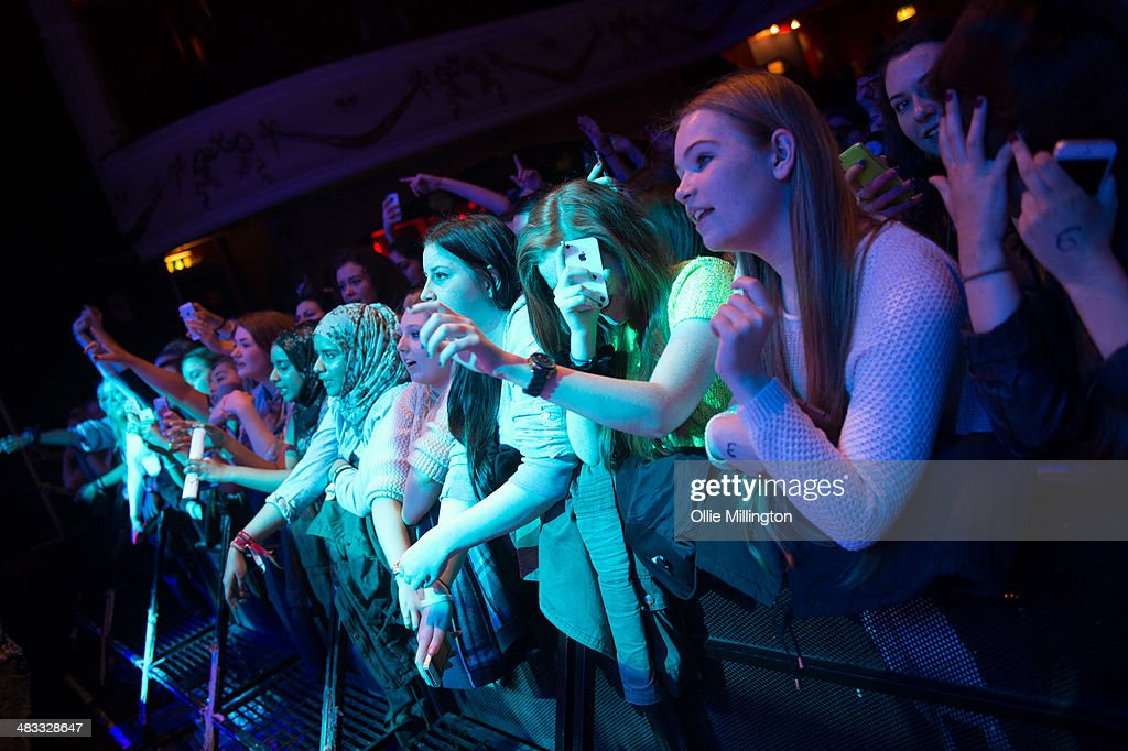 The crowd watch on as Luke Friend performs on stage at The Vamps 'Last Night' single launch party at Shepherds Bush Empire on April 7, 2014 in London, United Kingdom.