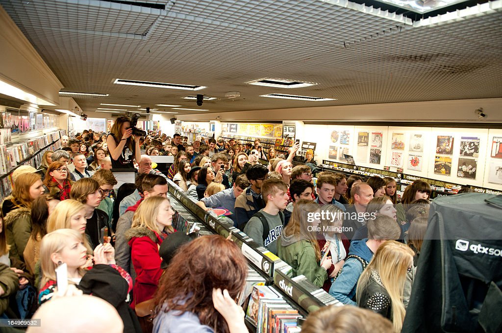 The crowd watch on as Peace perform during an instore gig at Head Records to promote the release of their debut album 'In Love' on March 29, 2013 in Leamington Spa, England.