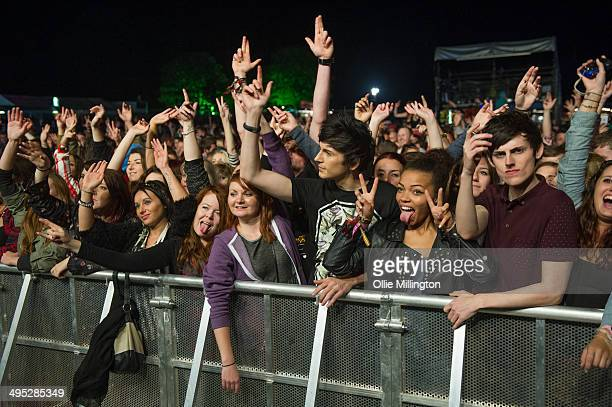 The crowd watch on as Rizzle Kicks perform on stage at Shakedown Festival 2013 at Stamner Park on September 28 2013 in Brighton England