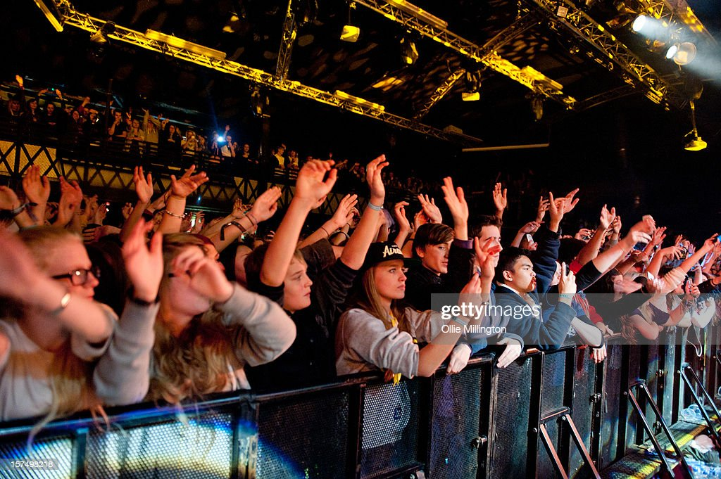 The Crowd watch on as Rizzle Kicks perform onstage during their December 2012 UK tour at Rock City on December 3, 2012 in Nottingham, England.