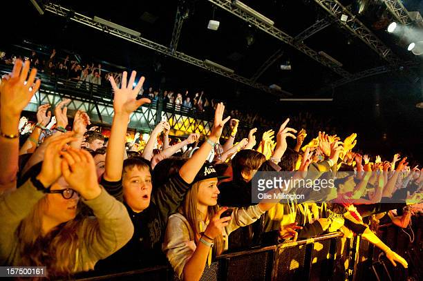 The crowd watch on as Rizzle Kicks perform onstage during their December 2012 UK tour at Rock City on December 3 2012 in Nottingham England