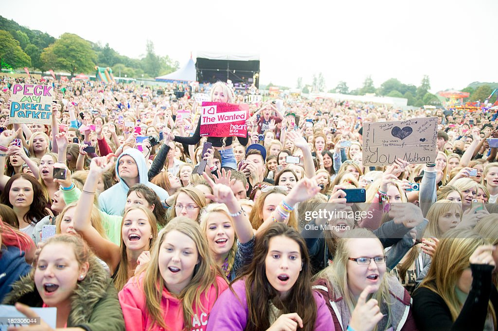 The crowd watch on as The Wanted performs on stage at SD2 Festival 2013 at Stamner Park on September 29, 2013 in Brighton, England.