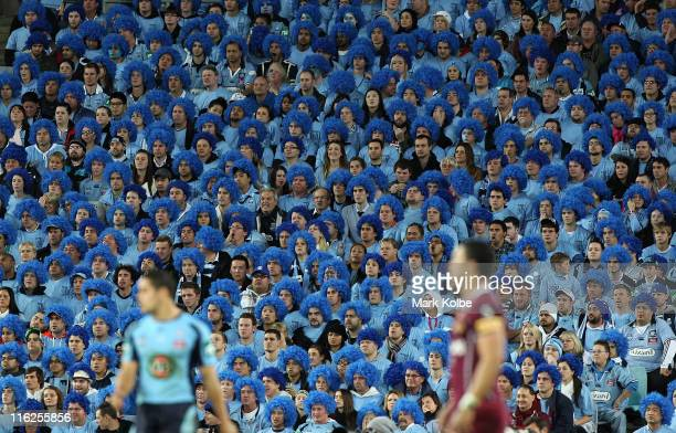 The crowd watch on during game two of the ARL State of Origin series between the New South Wales Blues and the Queensland Maroons at ANZ Stadium on...