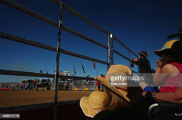 The crowd watch on during the Bull Ride Spectacular on the first day of the 2014 Deni Ute Muster at the Play on the Plains Festival grounds on...
