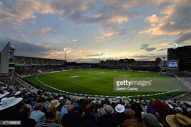 The crowd watch play as the sun sets during the 4th ODI Royal London OneDay match between England and New Zealand at Trent Bridge on June 17 2015 in...
