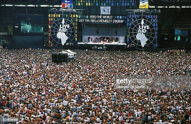 The crowd watch the Live Aid concert at Wembley Stadium on 13 July 1985 in London England