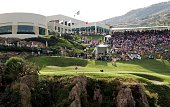 The crowd watches as Lorena Ochoa of Mexico putts on the 18th hole during round 3 of the Corona Morelia Championship on October 7 2006 at Tres Marias...