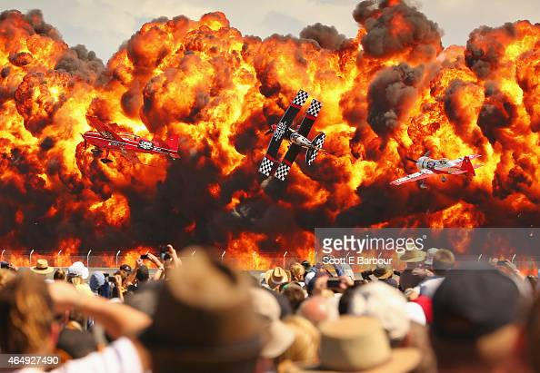 The crowd watches as stunt pilots Melissa Pemberton Jurgis Kairys and Skip Stewart of The Immortals fly past pyrotechnics as they perform at The...