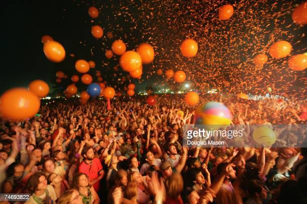 The crowd watches the Flaming Lips perform on stage on day four of the Bonnaroo Music Arts Festival on June 17 2007 in Manchester Tennessee