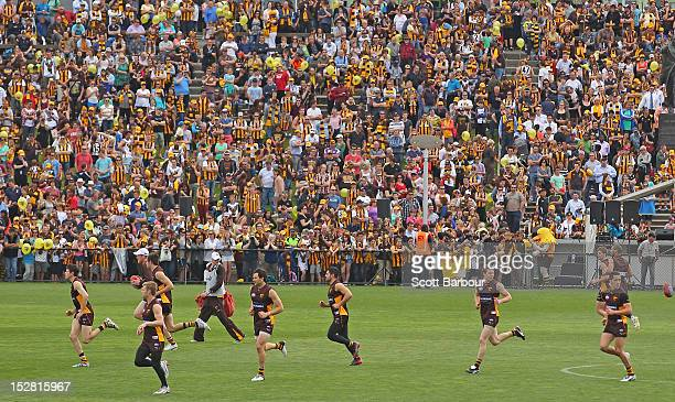 The crowd watches the Hawks run at a Hawthorn Hawks AFL training session at Waverley Park during AFL Grand Final Week in Melbourne on September 27...