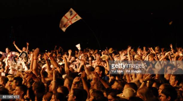 The crowd watching The Prodigy perform live onstage during the annual Isle of Wight festival at Seaclose Park in Newport Isle of Wight