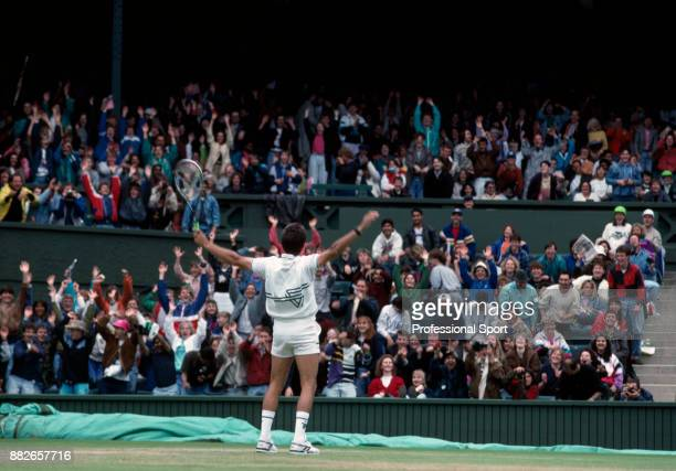 The crowd wave to Henri Leconte of France as he celebrates during the Wimbledon Lawn Tennis Championships at the All England Lawn Tennis and Croquet...