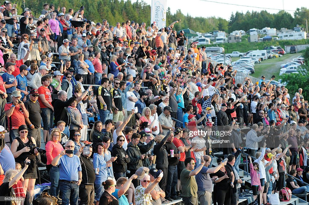 The crowd waves to drivers at the CRS Express 300 at Autodrome Chaudiere on June 24, 2016 in Vallee-Jonction, Quebec, Canada.