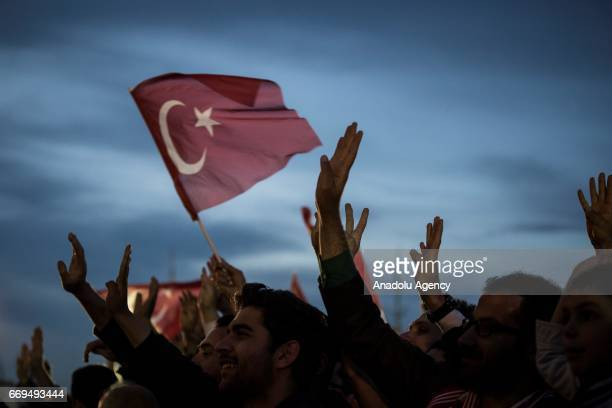The crowd who are celebrating the results of the referendum listen to Turkish President Recep Tayyip Erdogan at the Presidential Complex in Ankara...