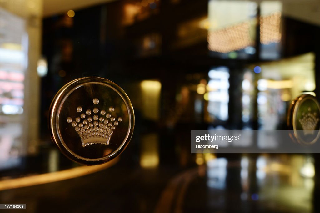 The Crown Ltd. logo decorates the doors at the entrance to the Crown Towers hotel, part of the Crown Melbourne casino and entertainment complex, in Melbourne, Australia, on Wednesday, Aug. 21, 2013. Crown Ltd., the gaming company controlled by billionaire James Packer, is scheduled to announce full-year results on Aug. 23. Photographer: Carla Gottgens/Bloomberg via Getty Images