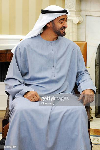 The Crown Prince of Abu Dhabi Sheikh Mohammed Bin Zayed Al Nahyan from the United Arab Emirates speaks with US President Barack Obama unseen during a...
