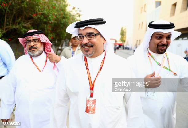 The Crown Prince of Bahrain Prince Salman bin Hamad bin Isa Al Khalifa walks in the Paddock during practice for the Bahrain Formula One Grand Prix at...