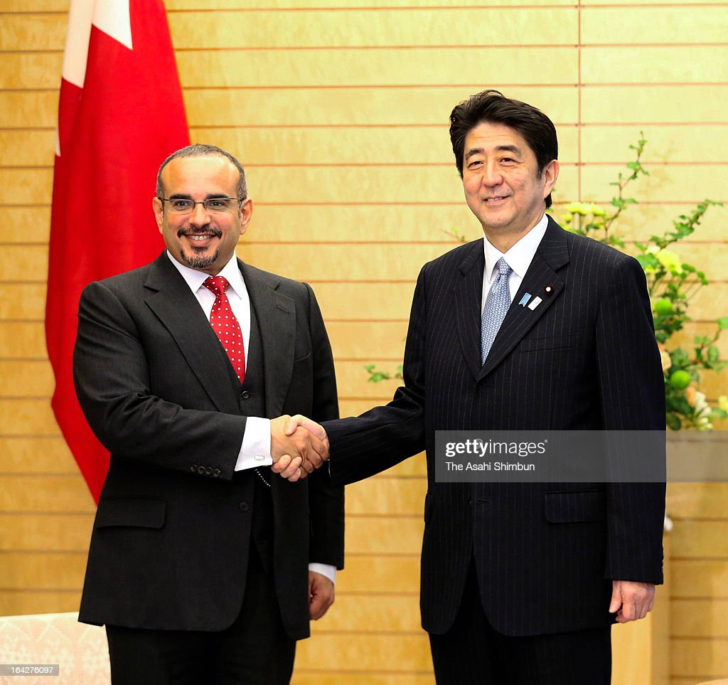 The Crown Prince of Bahrain Salman bin Hamad bin Isa Al Khalifa (L) shakes hands with Prime Minister Shinzo Abe of Japan during their meeting at the prime minister's official residence on March 21, 2013 in Tokyo, Japan.
