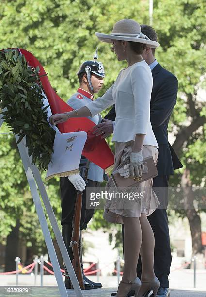 The Crown Prince of Denmark Frederick and his wife Mary Donaldson take part in a wreathlaying ceremony in front of La Moneda Presidential palace in...
