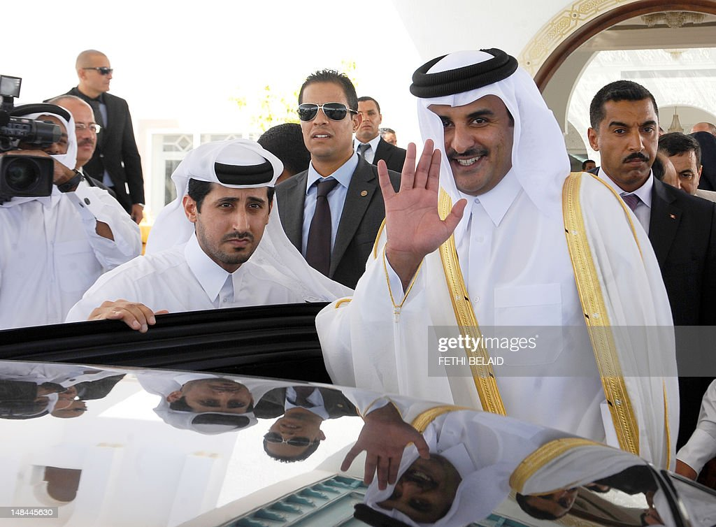 The Crown Prince of Qatar Sheikh Tamim bin Hamad Al-Thani waves for photographers upon his arrival in Tunis on July 16, 2012. Sheikh Tamim is on two day official visit to Tunisia at the invitation of the government.