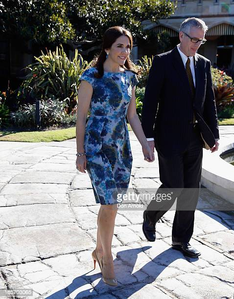 The Crown Princess Mary of Denmark and Christopher Sullivan take a stroll inside the gardens of Government House on October 24 2013 in Sydney...
