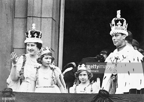 The crowned King George VI and Queen Elizabeth with Princess Elizabeth and Princess Margaret Rose acknowledging the cheers of the crowd from the...