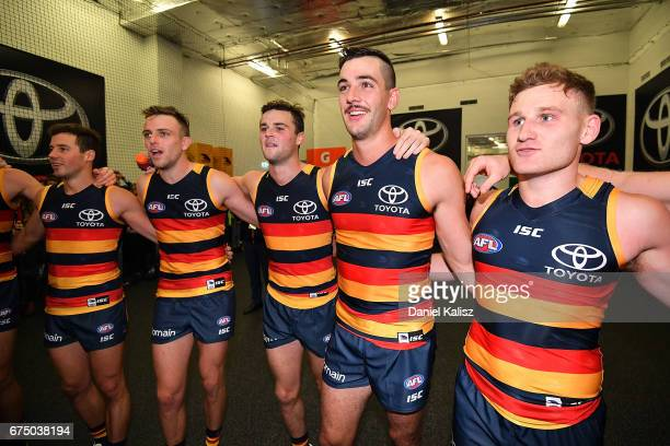 The Crows players sing the club song after defeating the Tigers during the round six AFL match between the Adelaide Crows and the Richmond Tigers at...