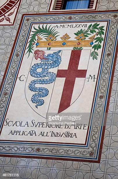 The cruciform escutcheon and the biscione at the Sforza Castle art school coat of arms Milan Italy 2013