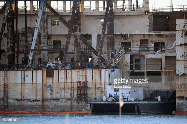 The cruise ship Costa Concordia is dismantled in the port of Genoa on January 13 2016 in Genoa Italy 32 people were killed after the ship hit a rock...