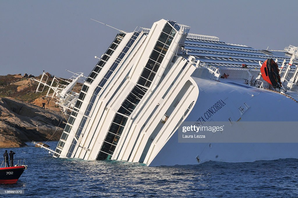 The cruise ship Costa Concordia lies stricken off the shore of the island of Giglio on January 14 2012 in Giglio Porto Italy More than four thousand...