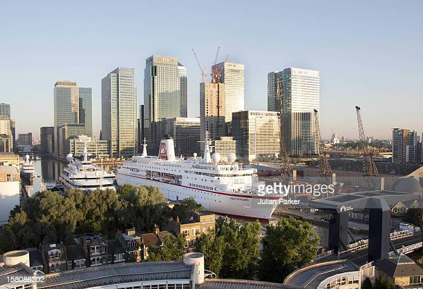 The Cruise Ship ' Ms Deutschland ' Is Edged Backwards Into West India Dock By Canary Wharf Early This Morning To Join Other Super Yachts Moored For...