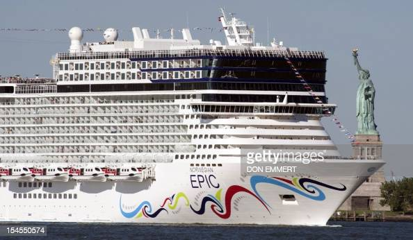 The cruise ship Norwegian Epic sails past the Statue of Liberty July 1 2010 in New York Harbor The Norwegian Cruise Line ship on her Maiden Voyage...