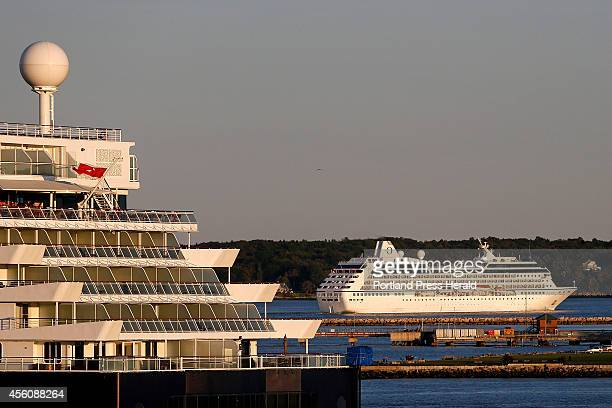The cruise ship Summit at left with around 3000 people on board including passengers and crew sits docked at Ocean Gateway Terminal in Portland...