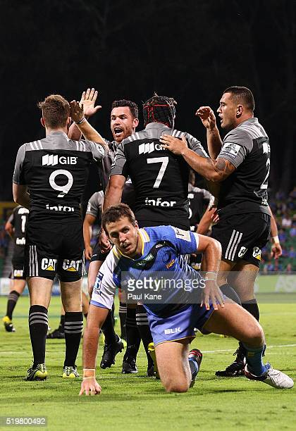 The Crusaders celebrate a try by Mitchell Drummond during the round seven Super Rugby match between the Force and the Crusaders at nib Stadium on...