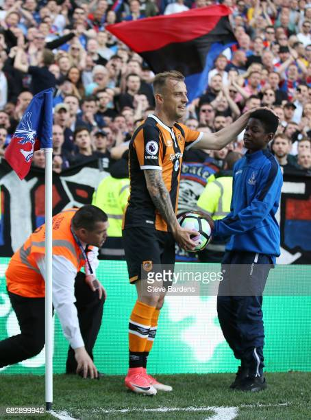 The Crystal Palace ball boy gives Kamil Grosicki of Hull City the ball during the Premier League match between Crystal Palace and Hull City at...
