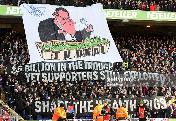The Crystal Palace fans hold up a banner to protest the Sky TV deal the Barclays Premier League match between Crystal Palace and Arsenal at Selhurst...