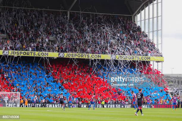 The Crystal Palace fans surport their team during the Premier League match between Crystal Palace and Huddersfield Town at Selhurst Park on August 12...