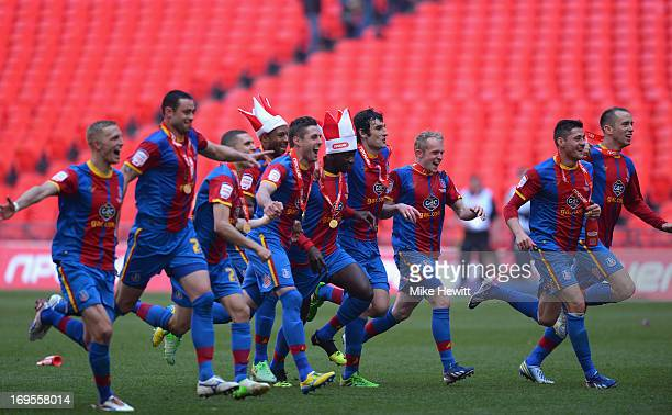 The Crystal Palace players celebrate following their victory in extratime during the npower Championship Playoff Final match between Watford and...
