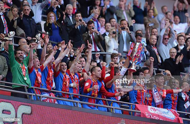 The Crystal Palace players celebrate with the trophy following their victory in extratime during the npower Championship Playoff Final match between...
